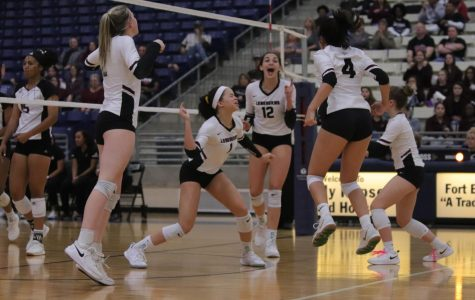 After a tough set, No. 1 Alex Tennon (11) gets her groove back with a solo block against Pearland's middle hitter.