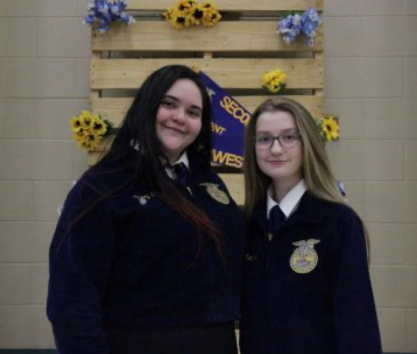 Casey+Morgan+%2811%29+and+Maddie+Roberts+%2811%29+attending+the+FFA+banquet.