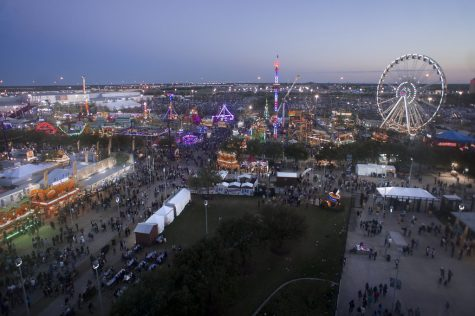 As night begins to fall on the Houston Livestock Show and Rodeo, the carnival is booming with life