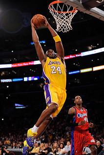 Kobe Bryant dunking the ball aggressively on the Los Angeles Clippers' Rasual Butler.  https://www.flickr.com/photos/boixoesnois1987/4067656449