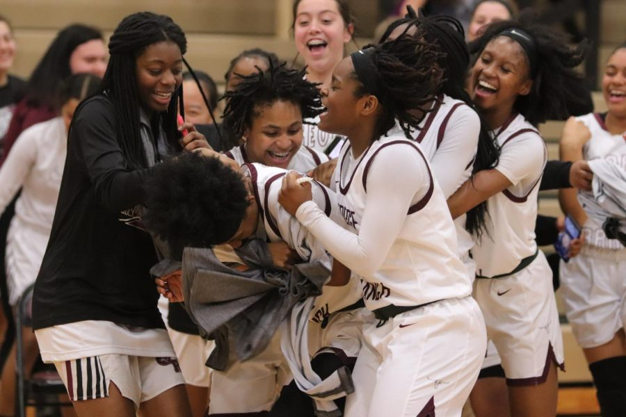 No. 12 Nyah Swafford (12) being swarmed by her excited team after the game ended with a final score of 71-38.
