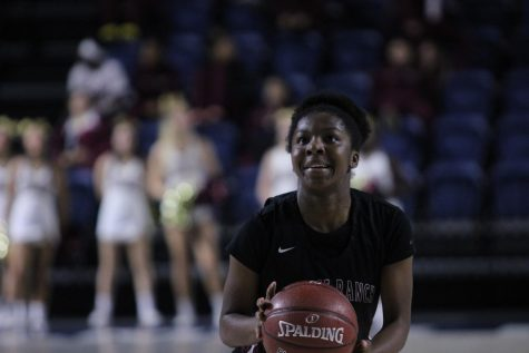 Rachel Okoye shoots a free throw to score a point for George Ranch.