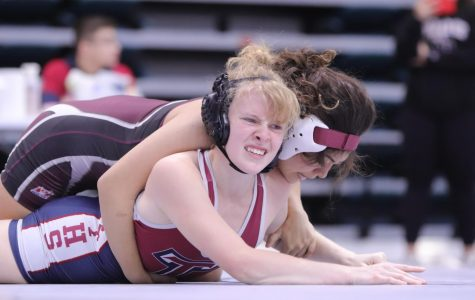 Kayley Perez (11) starting off her first round pinning Tompkins and trying to flip her over for the final pin.
