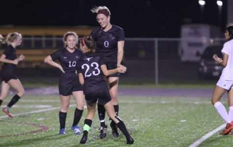 No. 0 Jenna Murray (12) and No. 23 Riley Grafe (12) celebrating the goal the two Longhorns made together.