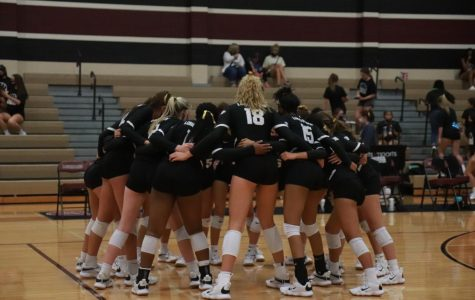 Allie Sczech (11) and her team doing their team chant before going onto the court to win their game.