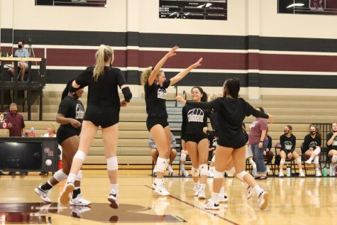 The varsity squad keeps the energy up in the last ten minutes of the scrimmage against Foster HS by hyping their teammates up after gaining a point.
