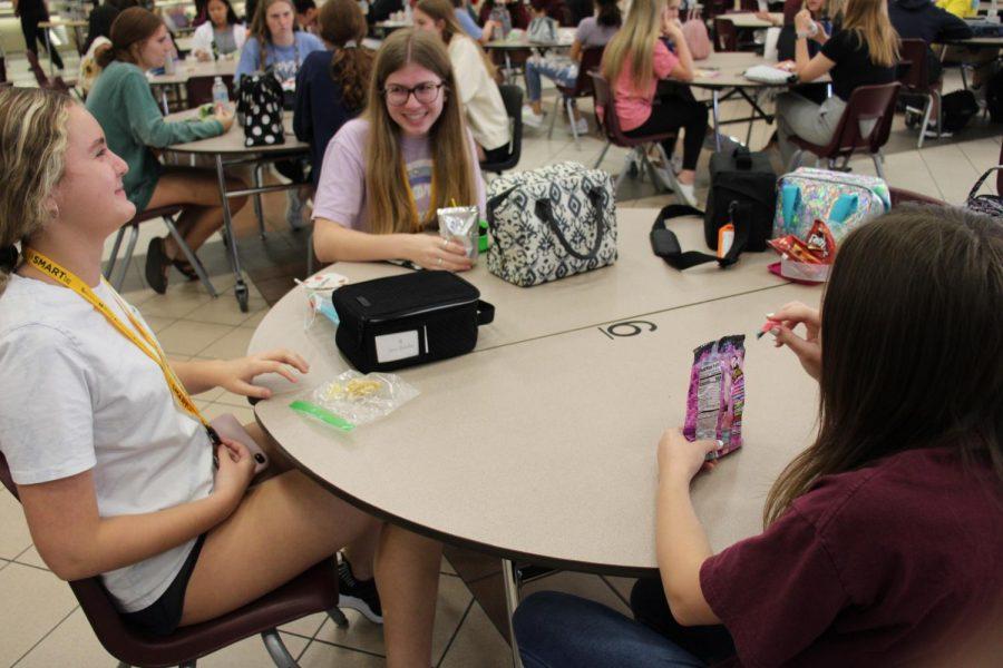 Amanda Doeling, Alexina Verona, and Katherine Cempa laugh to bring joy amid the changes.