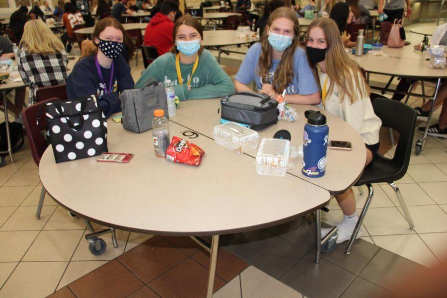 Kate Turnipseed, Rachel Scott, Lauren Spencer and Jordan Kulcak are all smiles underneath their mask at the lunch table.