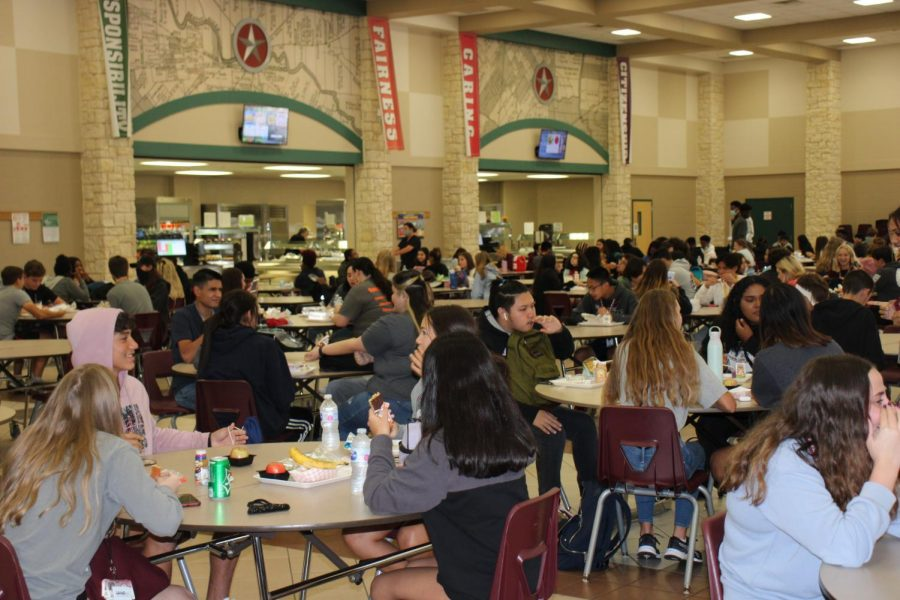 At lunch this year, students must sit four to a seat.