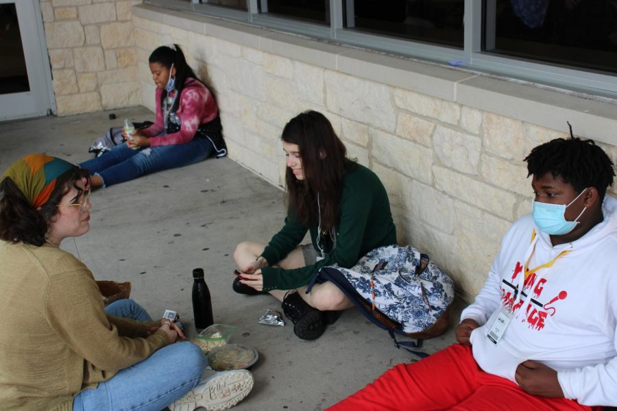 Taylor Moore, Carly Morgon  and Jacob Gay chat outside during lunch.