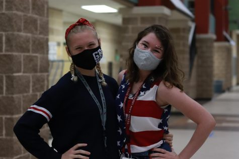 Kyra Apodaca (12) and Rachel Lafferty (12) proudly showing off their school spirit.