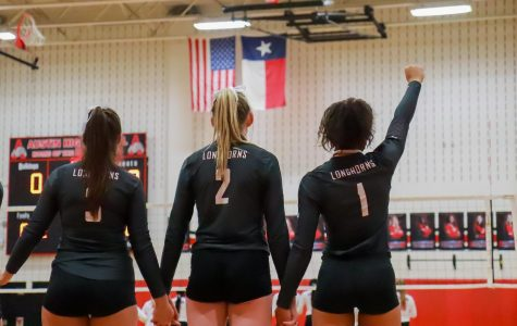 No. 3 Helen Watson (12), No. 2 Avery Shimaitis (11), and Alex Tennon (12), representing their team, stand as one whole.
