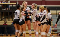 No. 7 Taylor Reeves (11) who is normally a defensive specialist, pulled a kill through for the winning point against Fort Bend Bush. Her team crowded around her with excitement.