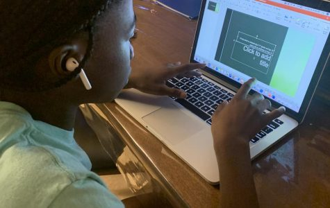 A student uses PowerPoint, a very common and popular program for projects.
