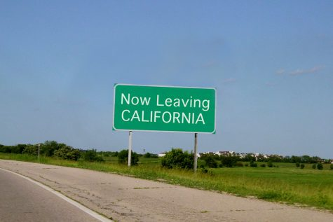 Road sign along the border of California as someone is leaving the state.
