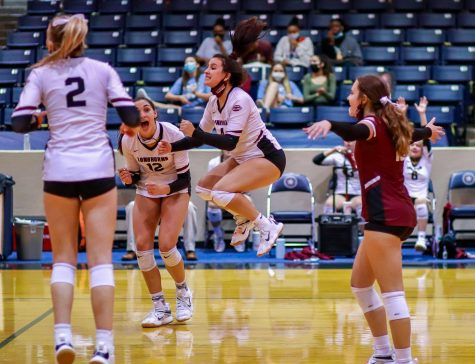 No. 4 Elyssa Giries (12) scores a point for the Longhorns.
