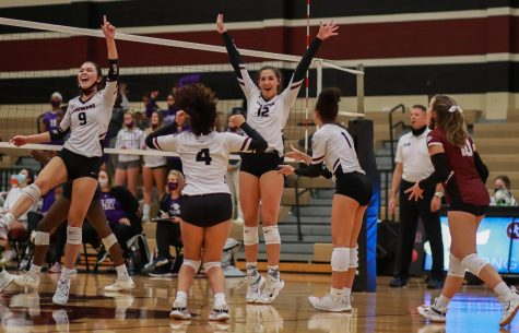 No. 12 Logan Lednicky (11) hands up with excitement after Lednicky successfully blocked the Panther