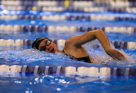 Keely Rollinson (12) competing in the girls 200m freestyle race. Rollison finished the race in first place with a final time of 1:56.57.