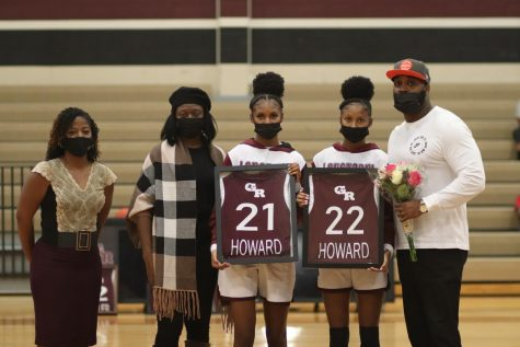 No. 21 Jada Howard (12) and No. 22 Jasmine Howard (12) being recognized for their contributions to the Girls Varsity Basketball Team.