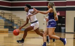 No. 10 Rachel Okoye (11) taking long strides down the gym against the Clements' guard and to further attempt a layup.