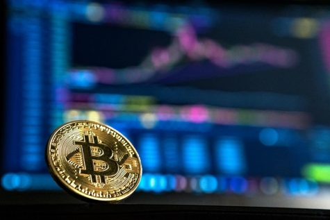 Bitcoin allows a person to buy products like normal currency, just without the need of a bank.