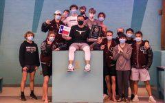 The boys' varsity swim team showcasing their