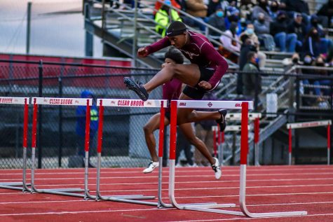 Bryce McCray (12) competing in the boys 110m hurdle race alongside his teammate Shane Gardner (11). McCray finished first with a time of 14.60 seconds, and Gardner second with a time of 15.06.