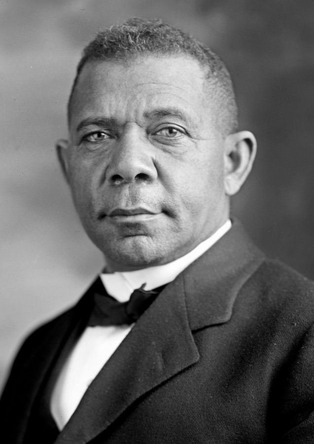 Booker T. Washington posing for a formal picture as he was a well known educator and writer.