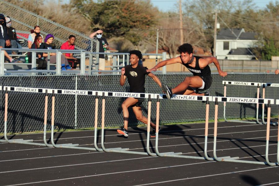Adrian Falkquay (9) with carefully timing out his step he was able to jump over the hurdles without touching them.
