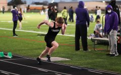 Cole Armstrong (9) went all out for the 400m. He came back with nothing left in him.