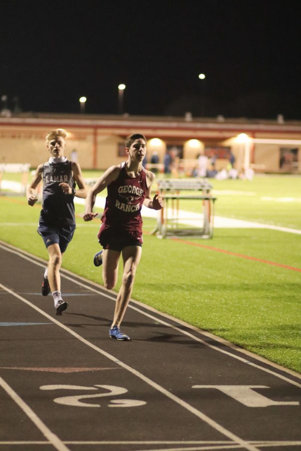 Ethan MacDonel (10) held a fast paste all through out the 1600m.