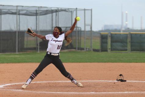 No. 10 Zaria Turner throwing a fast pitch over to the Elkins batter.