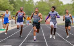Grant Celestine (12) won the district title in the boy's 400-meter dash with a new personal record time of 49.89.