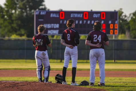 Will Krenek (12), Cole Murphy (11), and Reese Beheler (11) together for the Pledge of Allegiance.