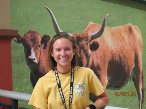 Kylie Marteney is all smiles in front of the longhorns.