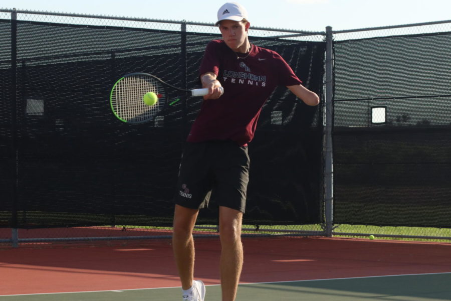 Clay Watson (10) hits a forehand back to his opponent.