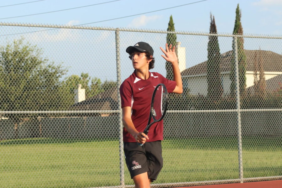 Santiago Allub (10) hitting a backhand volley after rushing the net.