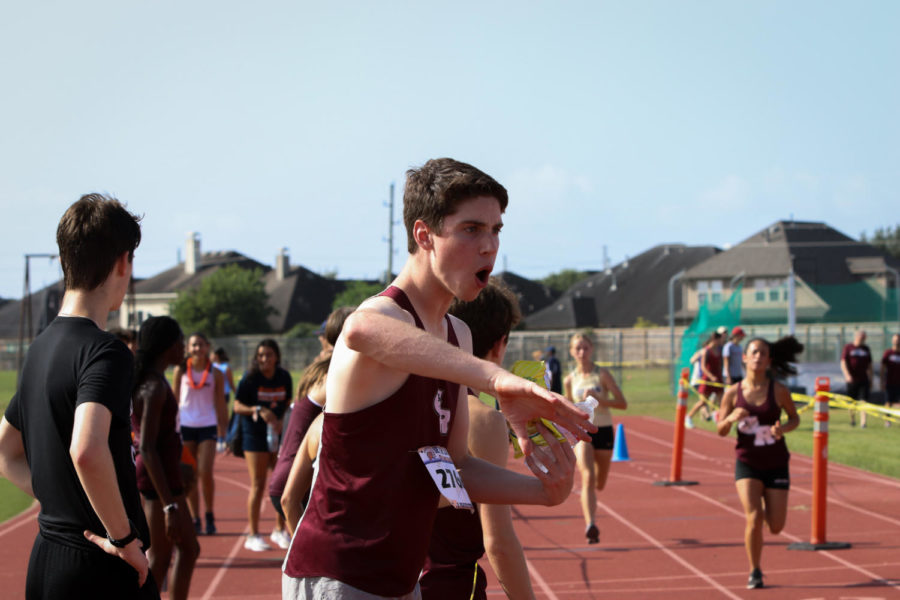 Ethan Macdonel (11) was cheering on his teammates as they finished.