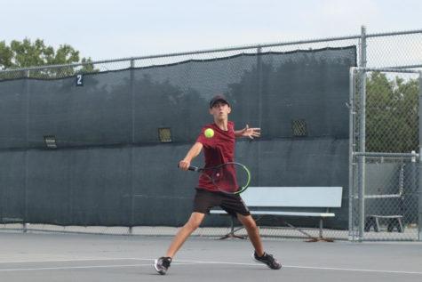 Hayden Gazaway (11) hitting a slice back over the net.